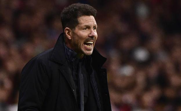 Simeone, ante la disputa del derbi./AFP