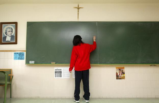 Aula de un centro educativo, en una imagen de archivo. / AFP PHOTO / CESAR MANSO